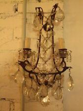 Applique in ferro e gocce di cristallo a due luci