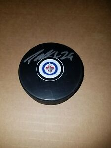 PATRIK-LAINE-SIGNED-JETS-LOGO-PUCK-EXACT-PROOF