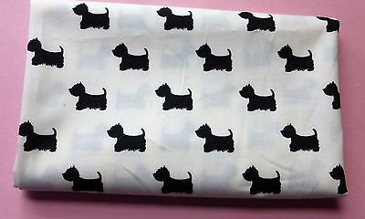 one metre cotton poplin with small black scottie dogs on ivory  background