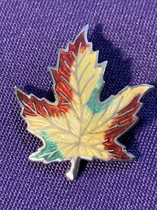 Vintage sterling silver brooch with enameled maple leaf motif