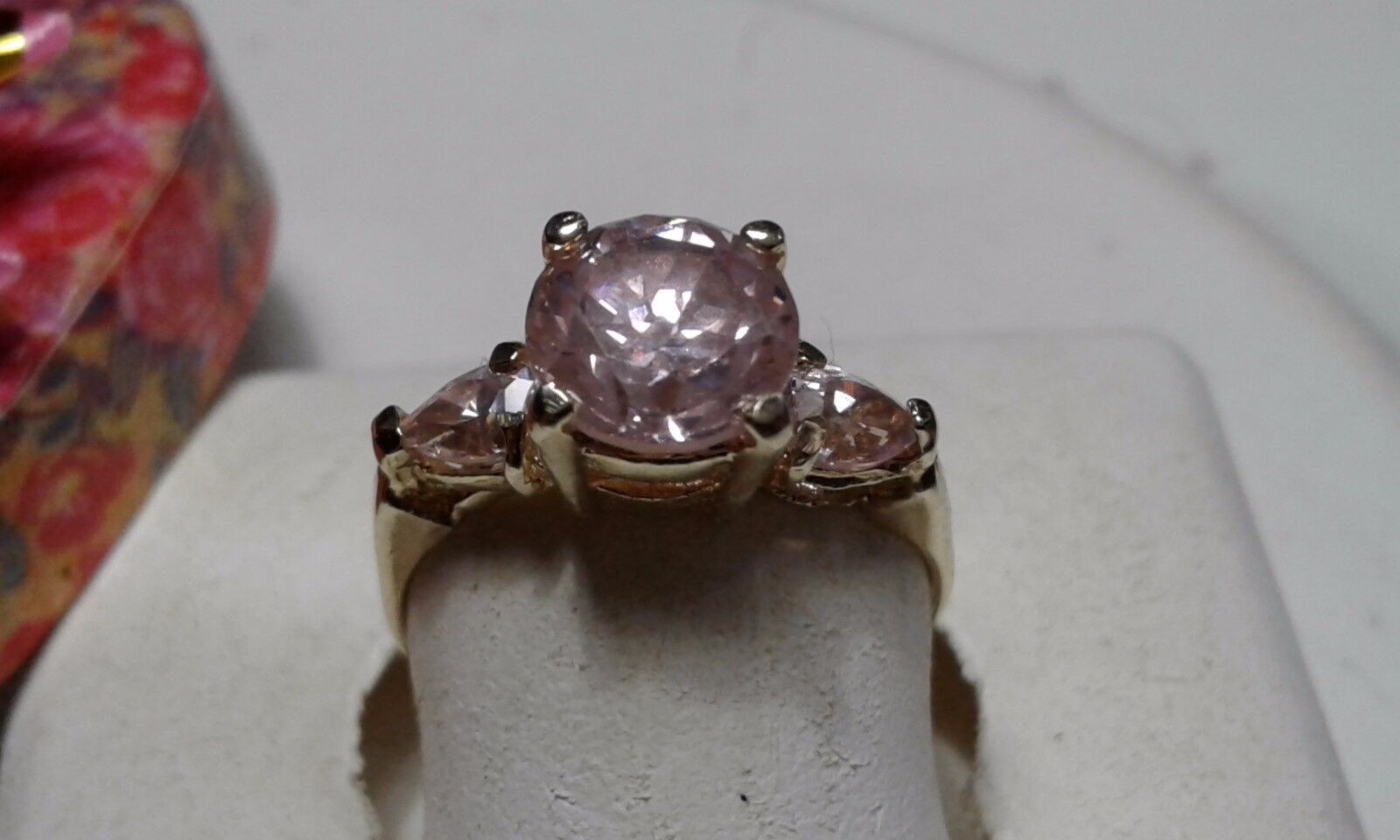 7mm Round & side Pear Hot Pink CZ 10Kt Yellow gold Basket 3 stone Ring