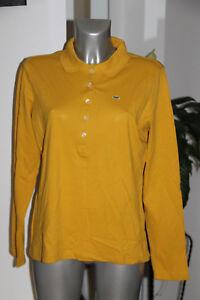 a7ecbaec064 polo manches longues jaune stretch femme LACOSTE taille 48fr ...