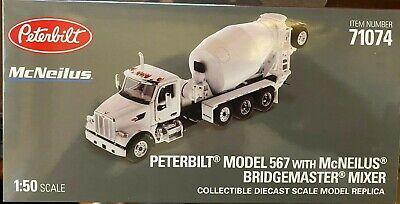 Peterbilt 567 with McNeilus Bridgemaster Mixer White and Gray 1//50 Diecast Model by Diecast Masters 71074