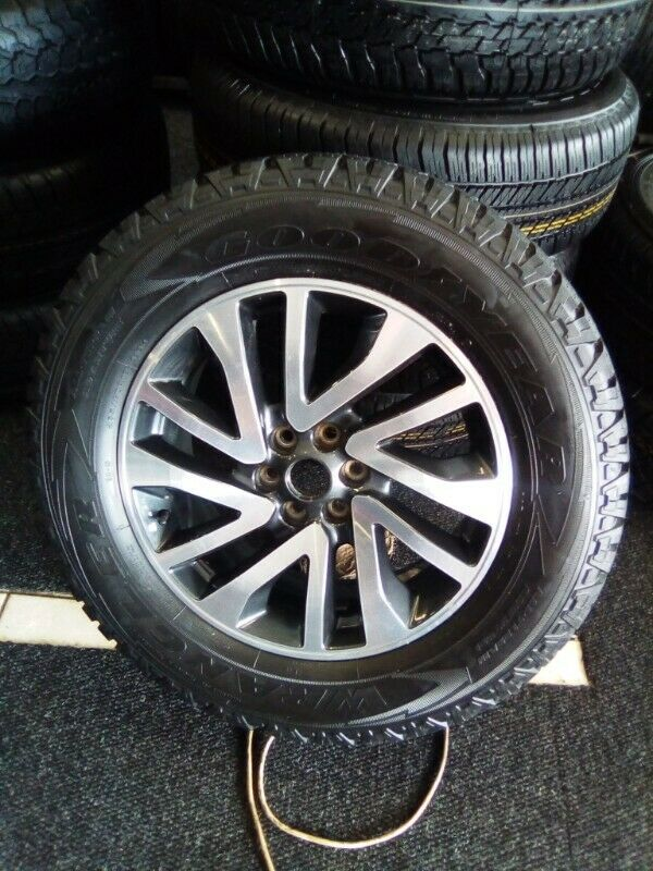 """18"""" Nissan Navara original mag with used tyre to use for spare R2250."""