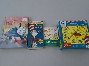 Lot of 7 dr suess books and puzzles, newer and vintage vhs , rare lot, bin146