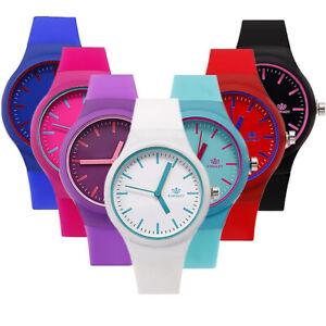 Frauen-Suessigkeits-Silikon-Band-keine-Zahl-runde-Vorwahlknopf-Quarz-Armbanduhr