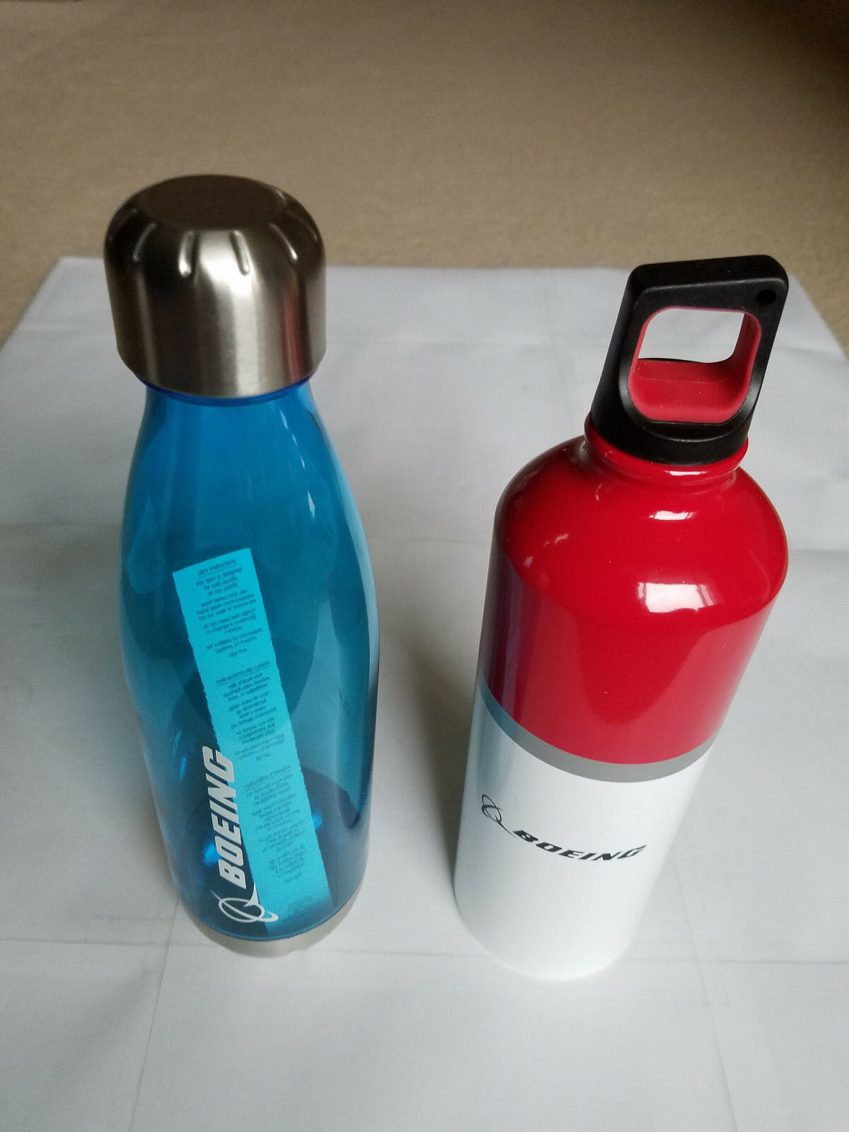 2 Boeing water bottles - one stainless steel and one plastic