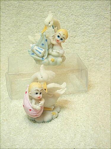 cicogna con bimbo e bimba. 2 bomboniere per nascita e battesimo