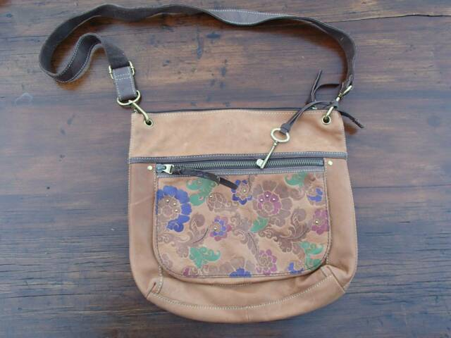 Tan leather fossil handbag with paisley details in great condition