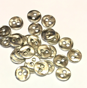20 x 11mm ivory opalescent shank buttons with opalescent effect on surface
