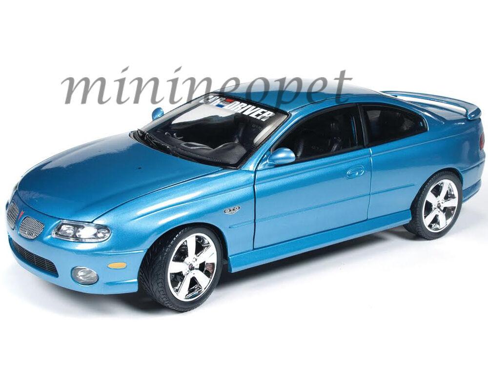 AUTOWORLD AMM1025 2004 04 PONTIAC GTO 1 18 CAR & DRIVER MAGAZINE DIECAST blueE