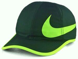3b87438634b NIKE Dri-Fit Featherlight black yellow hat cap Running Tennis ...