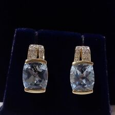 Aquamarine and diamond stud earrings in 9ct yellow gold