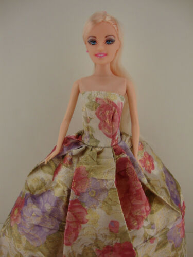 A Floral Gown with Metallic Floral Accents Made to Fit the Barbie Doll