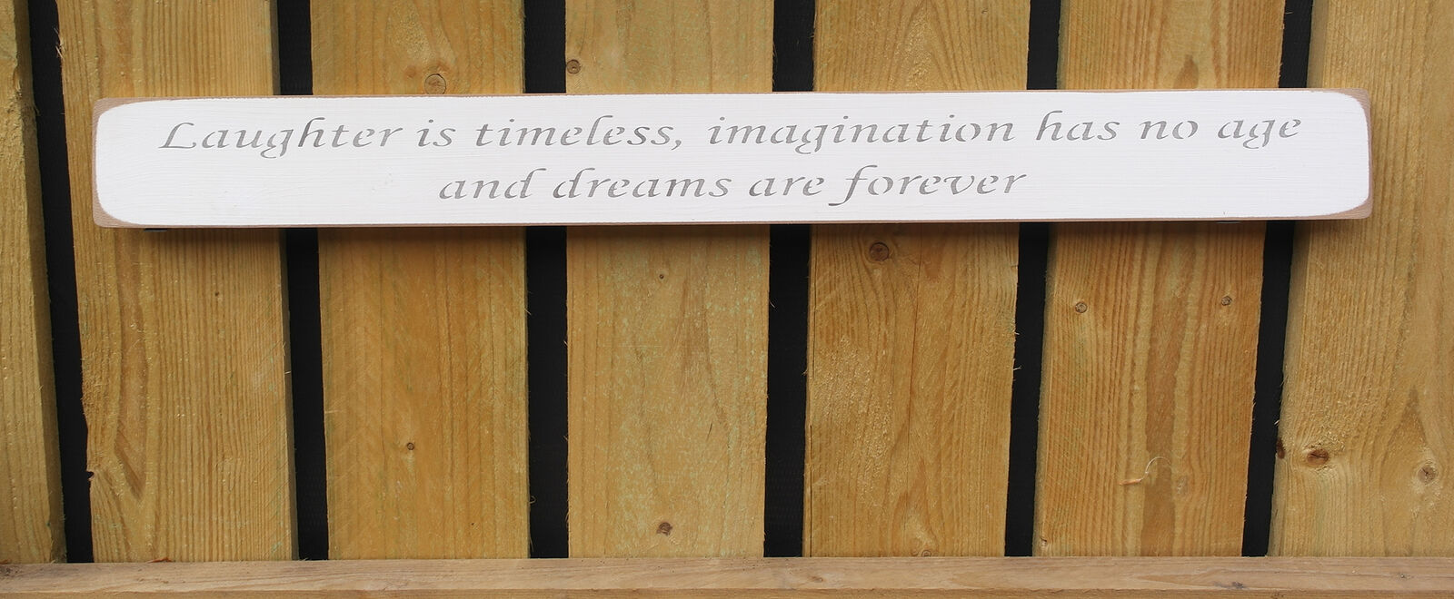 Handmade wooden sign Laughter is timeless, imagination has no age....