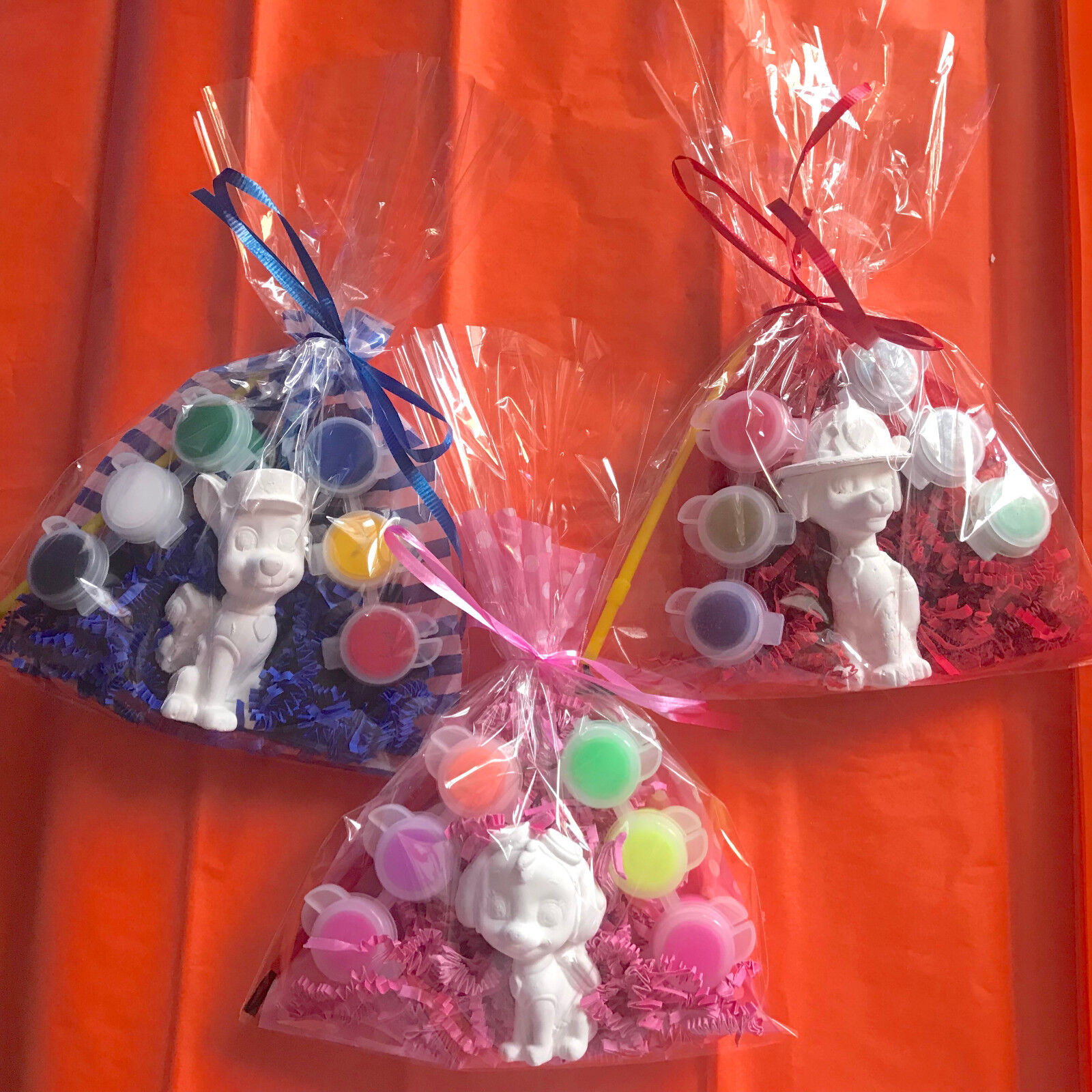 11 Paw patrol assorted party favors.Creative.To paint.1in a bag.PRICE PER 11 BAG