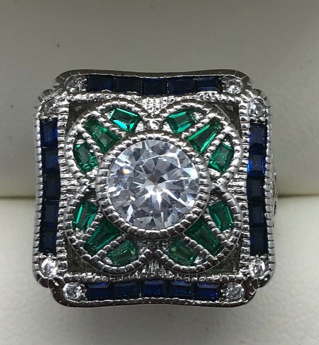 Ladies Fashion CZ, Emerald and Sapphire Ring with Pierced Scrollwork Sides sz 6