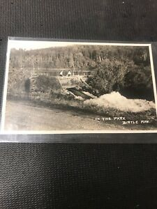 real-photo-postcard-Birtle-Woman-On-Bridge-In-The-Park-Birtle-Manitoba-A1