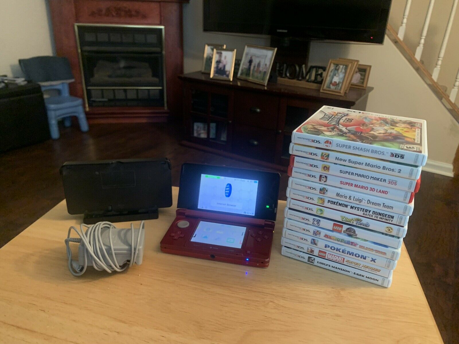 NINTENDO 3DS CONSOLE 12 GAMES CHARGER AND STAND on eBay thumbnail