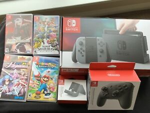 Nintendo Switch Console bundle (w/ 4 Games, Controller, and Accessories)