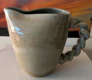 Unbranded Pitcher With Twisted braided Handle Red Clay blue glaze