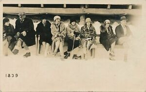 People Wearing Coats Lined Up Real Photo Postcard rppc - 1925