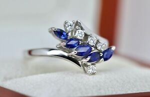 18ct White Gold 0.50ct Sapphire  and 0.33ct Diamond Bypass-style Ring