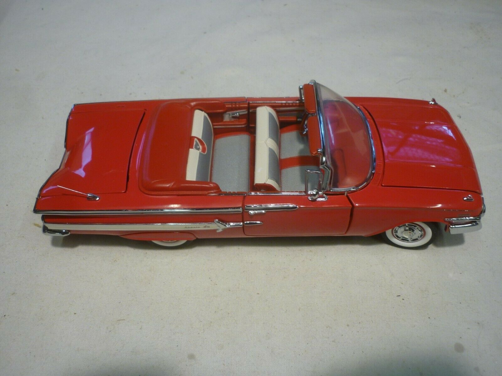 A Franklin mint scale model car of a 1960 Chevrolet impala. no box or paperwork