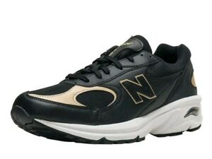 new balance black and gold