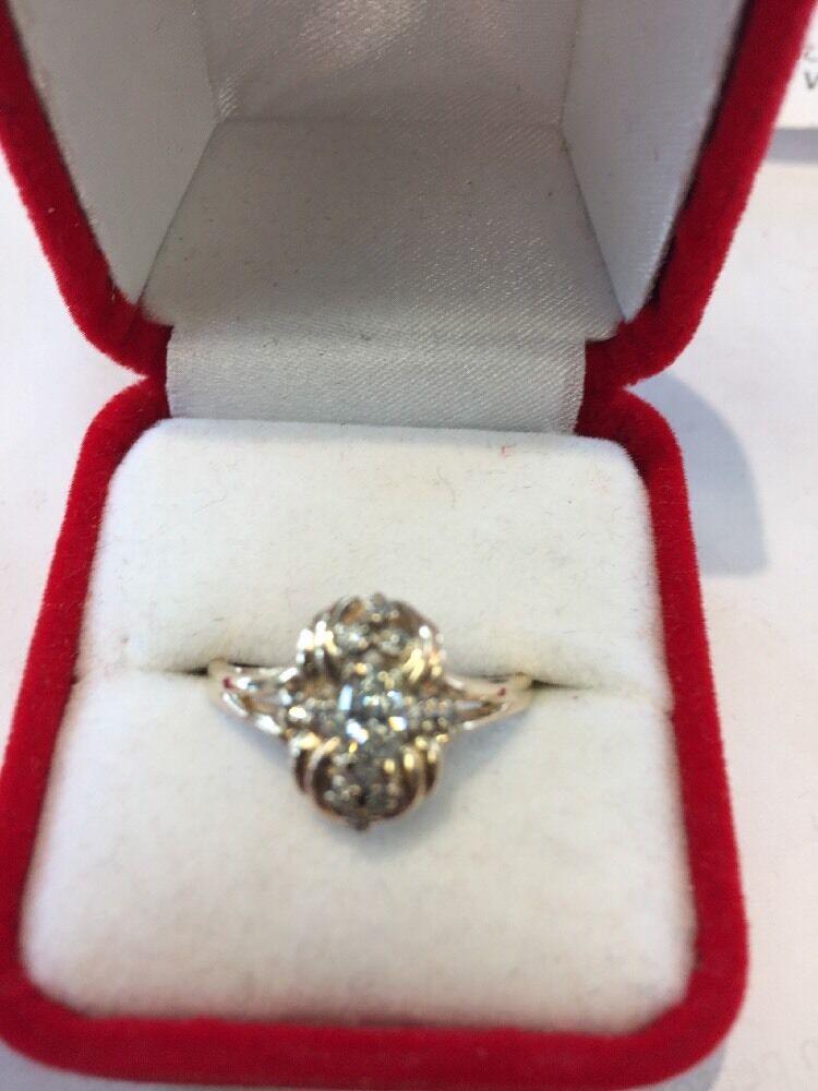 14 Kt  Marquise & Round Diamond Ring