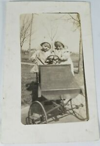 Vintage-Real-Photo-Post-Card-A-Pair-of-Toddlers-in-an-Early-Toy-Car-1900-039-s-AZO