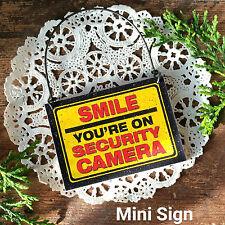 DECO Mini Sign Smile Security Camera Door Hanger Caution Surveillance Gag Gift