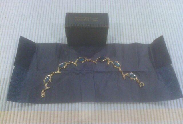 Avon Playful Dolphin Bracelet Goldtone 21cm