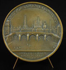 Medalla-sobrescribir-Louis-XIV-1585-construccion-el-puente-delante-de-la-Louvre