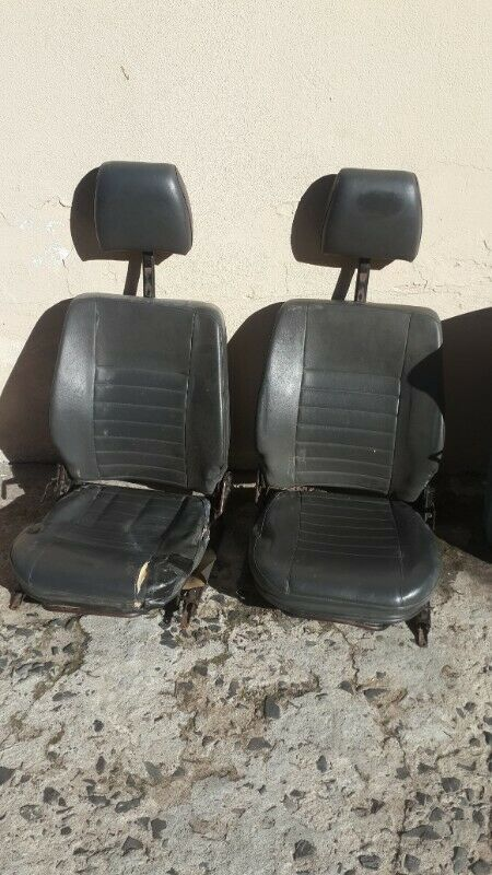 various original seats for land rover series/defender vehicles including damaged front seats