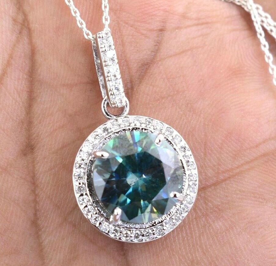 6.70 Cts Earth mined bluee Diamond Pendant With VVS White Diamond Accents