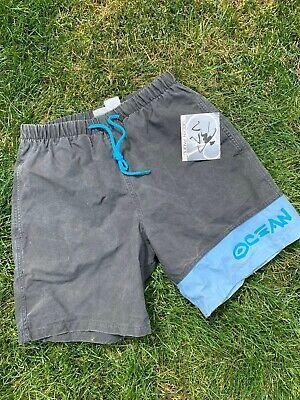 high waist graphic 80s print bermuda shorts \u00b7 neon beach gear \u00b7 vintage cartoon print trunks \u00b7 medium