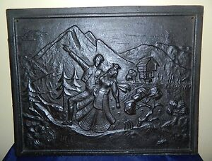 Antique Re-purposed Cast Iron Wall Plaque Of Couple Walking In The Mountains