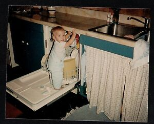 Vintage Photograph Adorable Baby Standing In Dishwasher In Retro