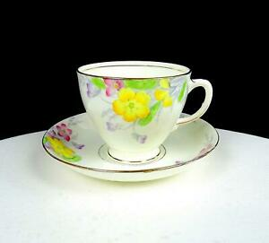 "OLD ROYAL ENGLAND #2112 YELLOW AND PINK FLORAL 2 3/4"" CUP AND SAUCER SET"