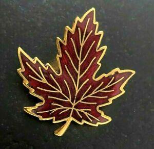 German Black Enamel and Gold Tone Metal Maple Leaf with Red Enamel Ladybug Brooch
