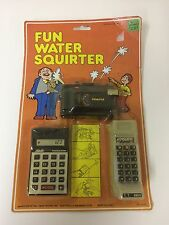 VINTAGE NEW SEALED Fun Water Squirter Toy Set Cell Phone Calculator Camera 1980