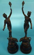 Art deco 1930s Spelter lady & man & Lion figures bakelite base Holding Flame x 2