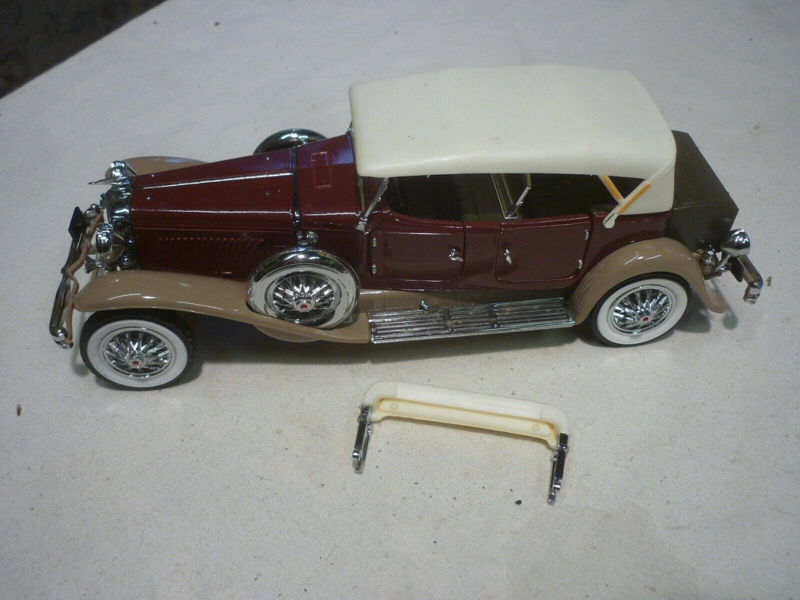 A Franklin mint scale model car of a 1930 Duesenberg J Derham Phaeton, no box