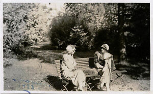 TWO PRETTY STYLISH YOUNG WOMEN SITTING IN PARK ca 1923 REAL PHOTO POSTCARD