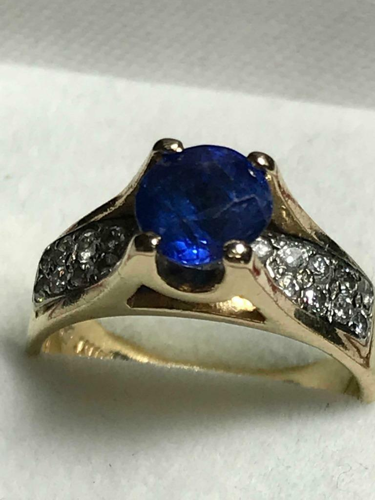 Gorgeous Luster bluee Sapphire and Crystal Clear Diamonds in 14k Yellow gold Ring