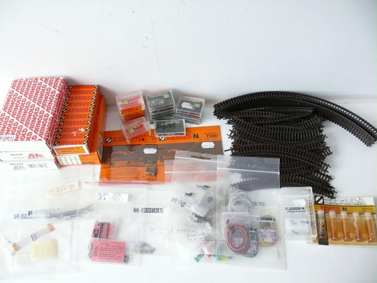 Arnold N - Konvolut Set Gleise Ersatzteile Nachrüstsätze Decoder Öl Kabel etc.