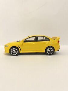 Realtoy 1:64 Mitsubishi Lancer Evolution en amarillo hecho en China (379)