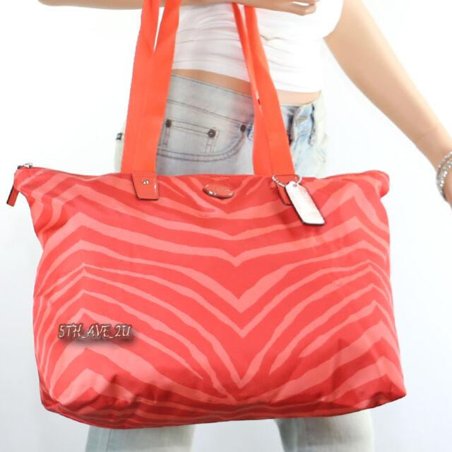 b851264cbbd1 ... inexpensive nwt coach zebra animal print packable weekender tote bag  f77526 orange new a6e0c add77 ...