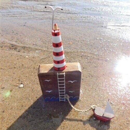 Lighthouse with gulls and boat Coastal Seaside Shoeless Joe Lighthouse bay